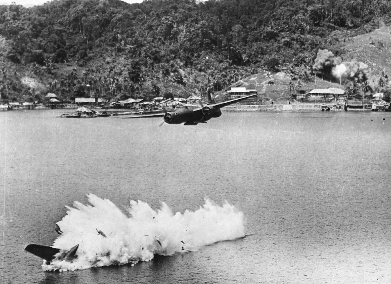 Two of twelve U.S. A-20 Havoc light bombers on a mission against Kokas, Indonesia in July of 1943. The lower bomber was hit by anti-aircraft fire after dropping its bombs, and plunged into the sea, killing both crew members.