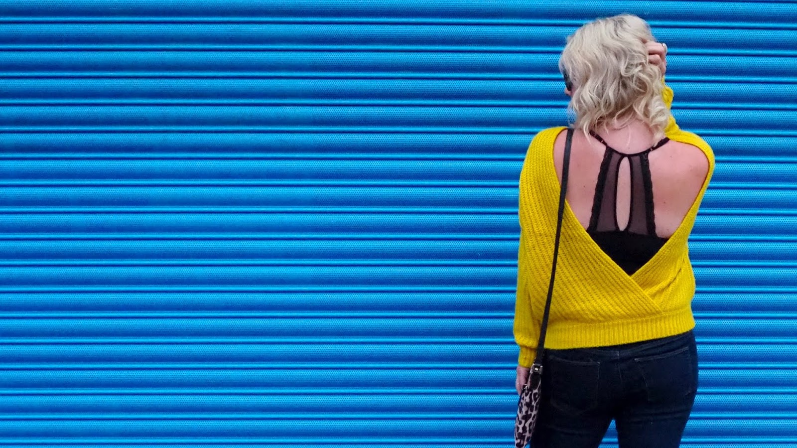 backless yellow jumper with lacy black racerback bra