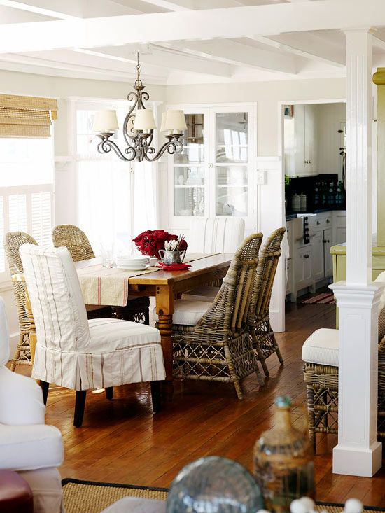 Rattan chairs mixed with slipcovered ones in the dining room