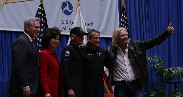 Virgin Galactic pilots Mark Stucky (second from right) and Frederick Sturckow (at center) pose with Deputy Secretary of the Department of Transportation Jeff Rosen (at left), Secretary of Transportation Elaine Chao and Virgin Galactic founder Sir Richard Branson after being awarded Federal Aviation Administration (FAA) Commercial Astronaut wings on Thursday, Feb. 7, 2019 at the U.S. Department of Transportation in Washington, DC. (Virgin Galactic)