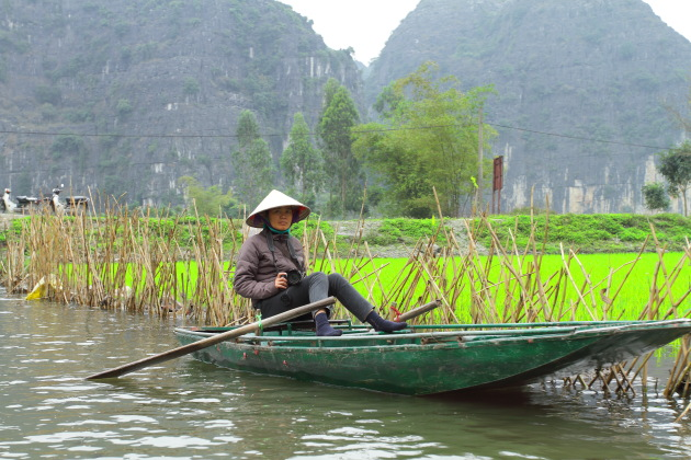Local photographer Vietnamese lady and her boat, Ninh Binh, Vietnam