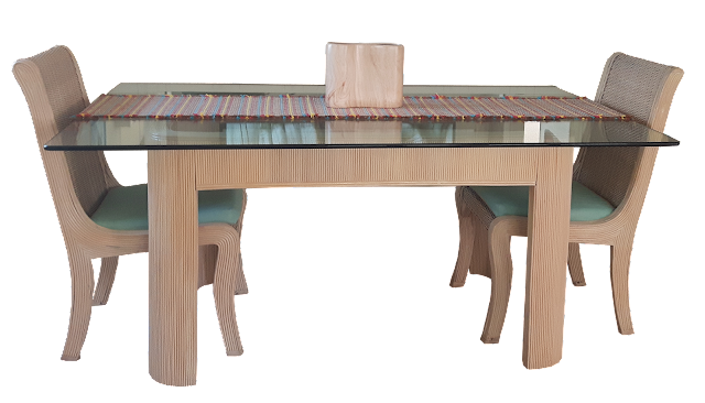 "A heavy glass-topped dining table with bamboo legs, and chairs. A very ""Floridian"" type of furniture."