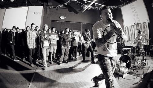 Stan from Out Crowd Atlanta straight edge singing at a show