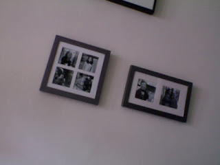image of two metal photo frames on a wall with black and white images of family and friends