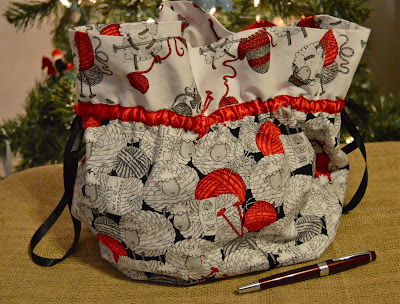 Hand sewn knitting project bag using fabric with knitting sheep I received as a Christmas gift.