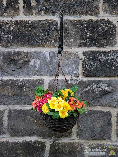 Any container such as this cauldren, can be used to create flower baskets