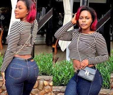 Sexy Nigerian female soldier flaunts her curves in tight Jean and crop top