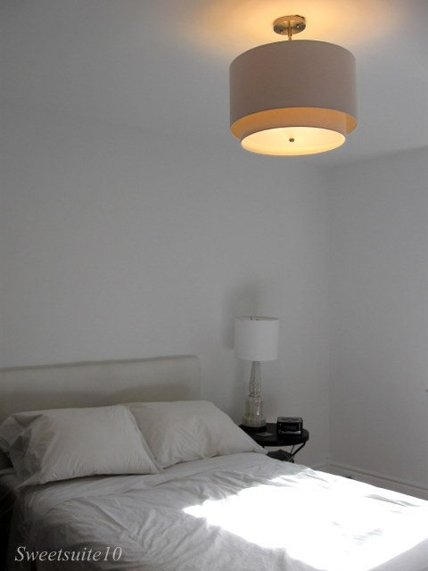 Bedroom with new drum shade overhead light