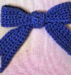 http://www.craftsy.com/pattern/crocheting/accessory/bow-motif/12671