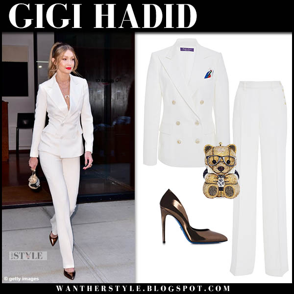 Gigi Hadid in white blazer, white pants ralph lauren and metallic pumps loriblu model style october 23