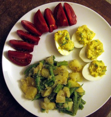 Potato green bean vinaigrette, deviled eggs, and fresh summer tomato