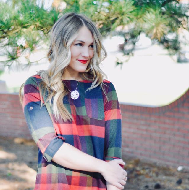 smiling blonde girl in festive plaid outfit