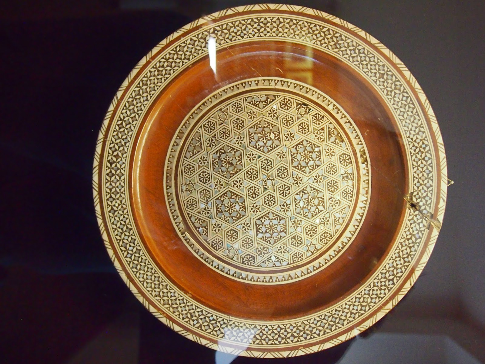 A brown and white decorative plate by Karaites in Trakai