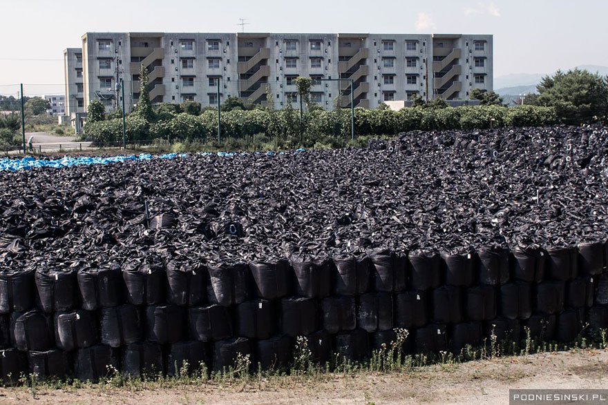 Bags of radioactive soil are stacked one on top of the other to save space - Never-Before-Seen Images Reveal How The Fukushima Exclusion Zone Was Swallowed By Nature