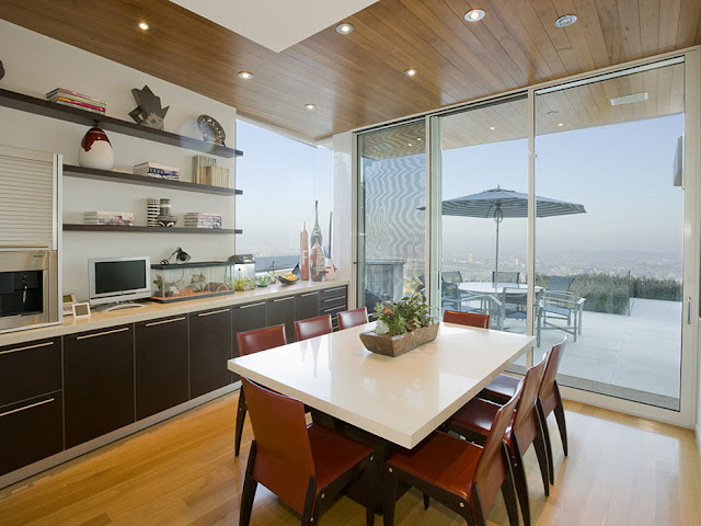 Small second kitchen and dining table in the modern mansion with the view