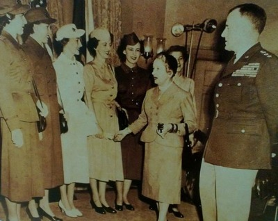 Hattie Carnegie meeting with group of Women's Army Corp in 1951.