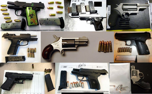 Firearms discovered in carry-on bags.