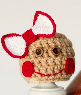 http://translate.google.es/translate?hl=es&sl=en&tl=es&u=http%3A%2F%2Fwww.hopefulhoney.com%2F2014%2F11%2Fbaby-gingerbread-hat-crochet-pattern.html
