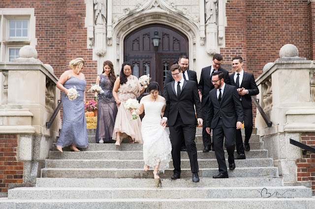 Bridal party walking down steps at Grosse Point Academy