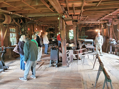 Interior of historic wagon works with belt-driven machinery