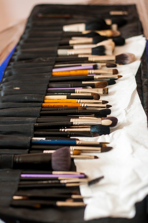 huge row of natural bristle makeup brushes