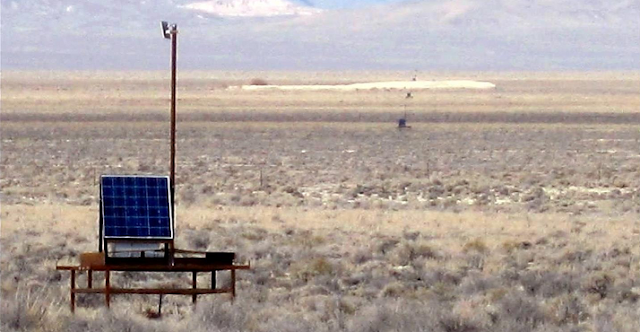 A Telescope Array Surface Detector and its neighbors, deployed in Utah's west desert. The 507 detectors are arranged on a grid covering 700 square kilometers, about the same as the land area of New York City. Credit: Telescope Array collaboration