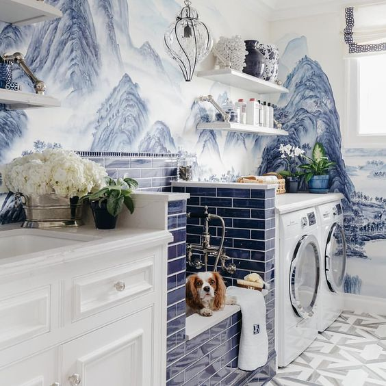 Vivid blue and white painted mural and tile in mud room with dog shower on Hello Lovely Studio