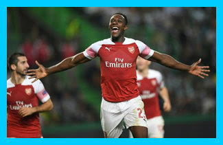 Danny Welbeck celebrates netting the winner for Arsenal in Lisbon