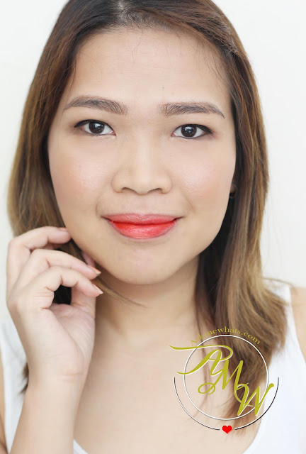 a photo of nikki tiu CLIO Virgin Kiss Tension Lip Butter Kiss, CLIO Virgin Kiss Tinted Lip Irony and CLIO Virgin Kiss SIlkuid in insane red review.