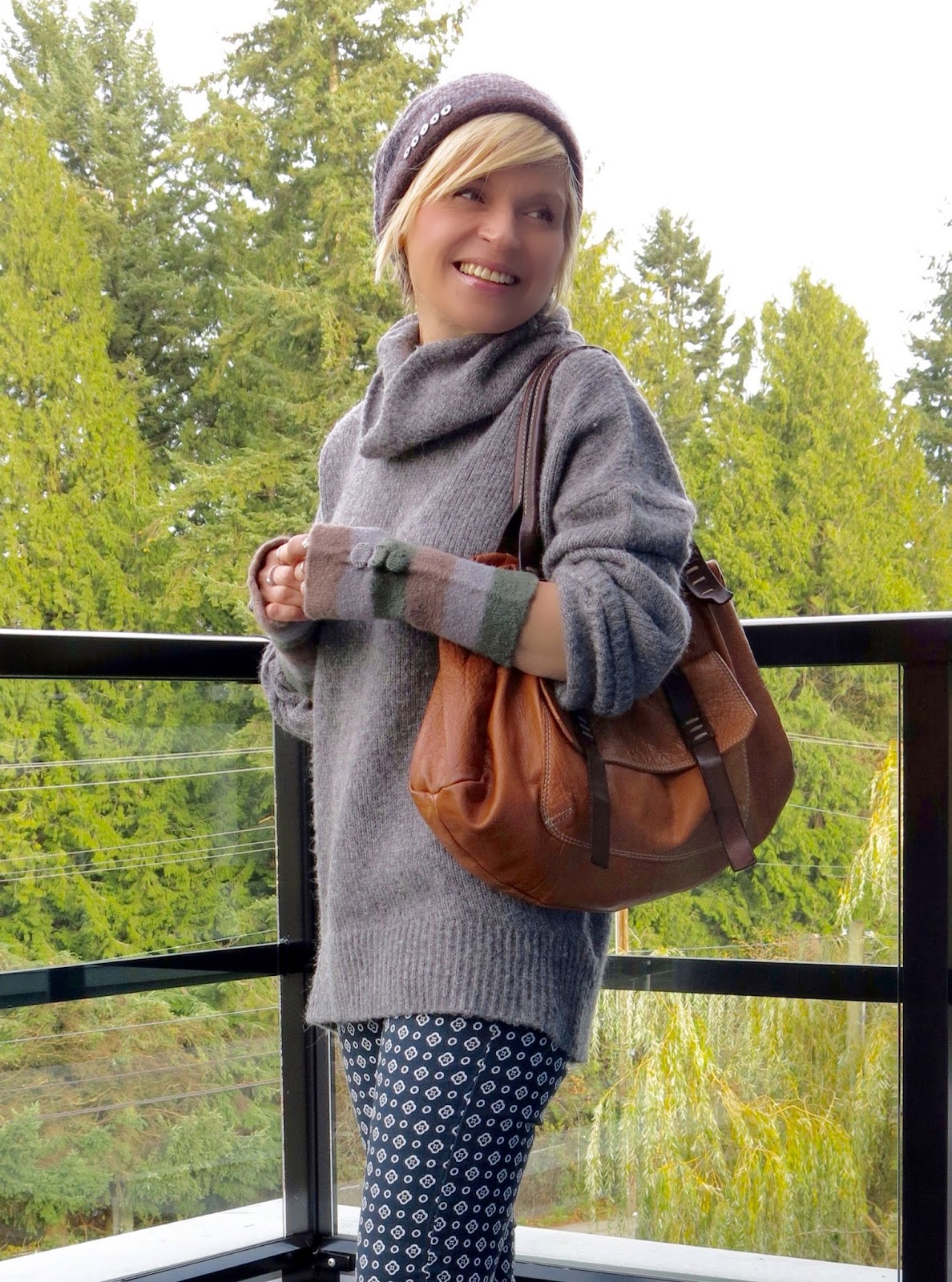 styling an oversized turtleneck with printed skinny pants, cognac satchel, and a woolen beanie