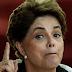 Dilma defende CPMF e diz que Brasil não paga muito imposto. Precisa de uma camisa de força.