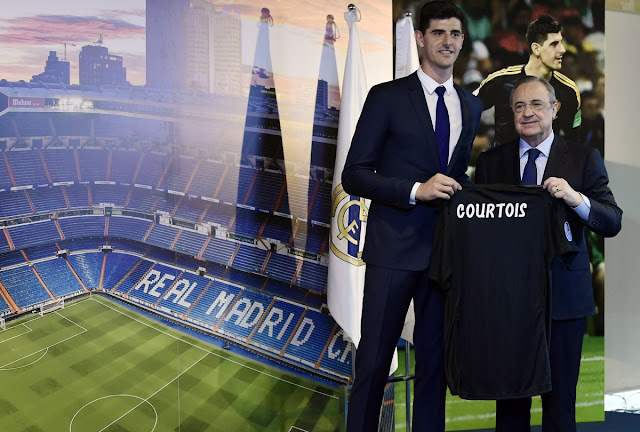 Thibaut Courtois and Real Madrid President Florentino Perez pose for a picture on his unveiling
