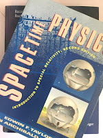 Spacetime Physics, by Taylor and Wheeler, superimposed on Intermediate Physics for Medicine and Biology.