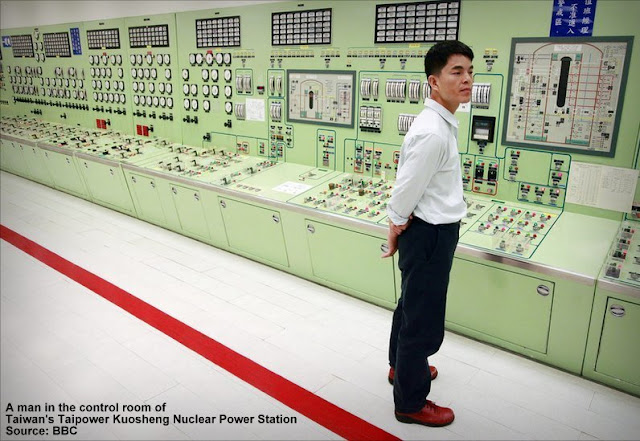 A man in the control room of Taiwan's Taipower Kuosheng nuclear power station