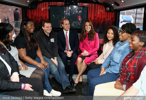 Catherine, Duchess of Cambridge and Prince William, Duke of Cambridge joke with young people on the top deck of the XLP Mobile recording Studio