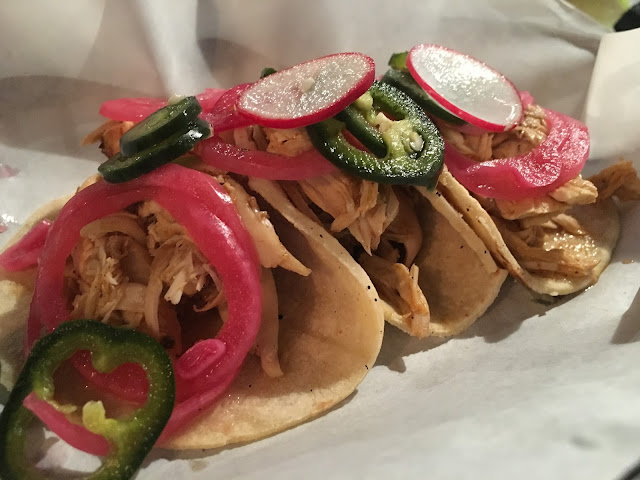 Chicken pibil with radish and pink pickled onions