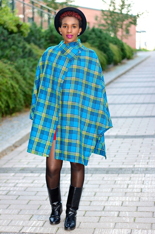 woman in maasai print wrap and black outdoor boots