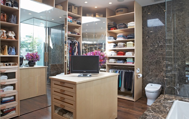 Feminine Closet By The Bathroom With Tv On Island Mirrored Doors And Deep Drawers Glass Fronts