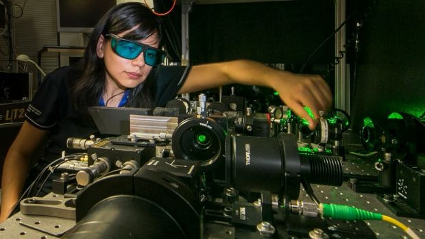 Rocio Camacho-Morales, a PhD candidate at the Australian National University. Here she adjusts the laser equipment in the laboratory of the Nonlinear Physics Centre at the ANU ~ PHOTO: ANU