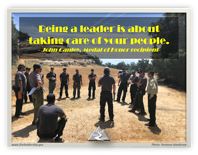 Being a leader is about taking care of your people. - John Canley, Medal of Honor Recipient  (circle of crew member in discussion)