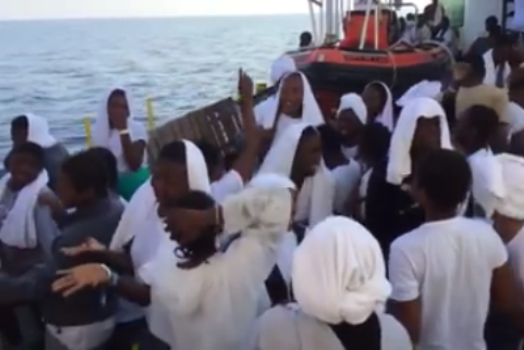 I WEEP FOR NIGERIA!!! SEE HOW NIGERIAN MIGRANTS RESCUED FROM LIBYA PRAISE GOD AS THEY SIGHT EUROPE