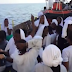 Nigerian migrants celebrates as the have their first sight of europe