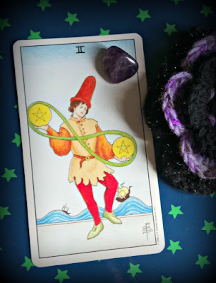 living the two of pentacles