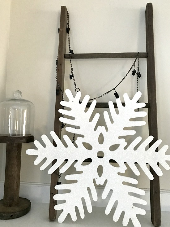 DIY mantel ladder and a glittery snowflake