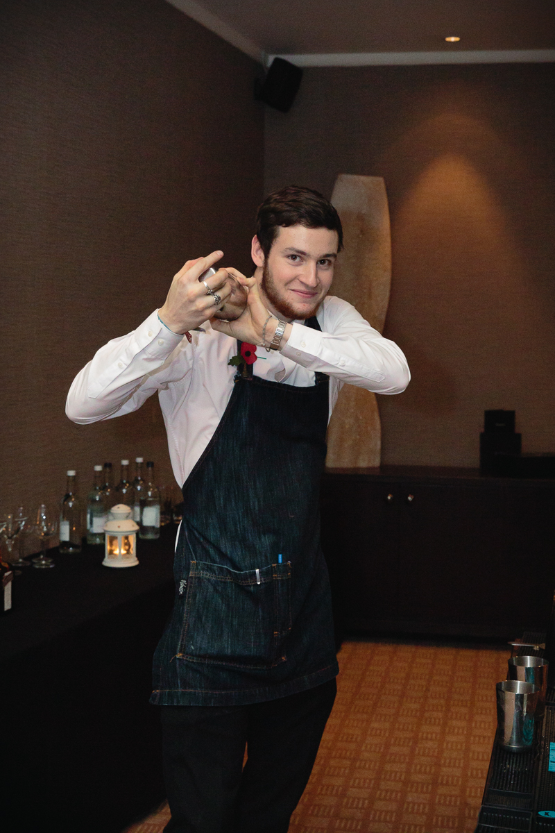 Bartender mixing cocktails at BonPrixOnTheRocks