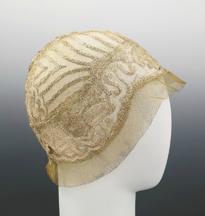 Beige lace 1925 evening cloche designed by House of Lanvin displayed on mannequin head