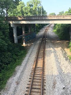 train track under bridge