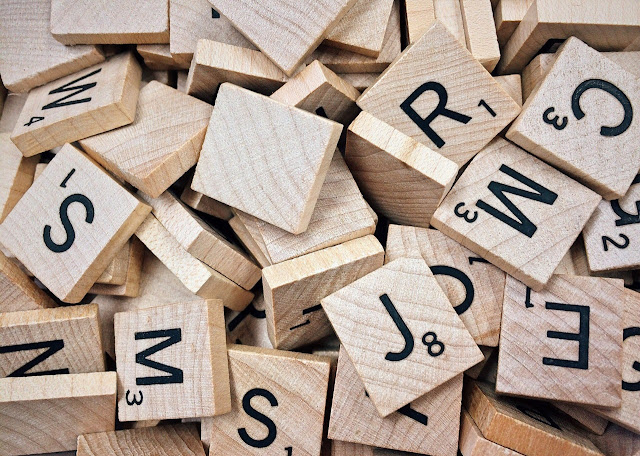 Scrabble tiles in pile, letters