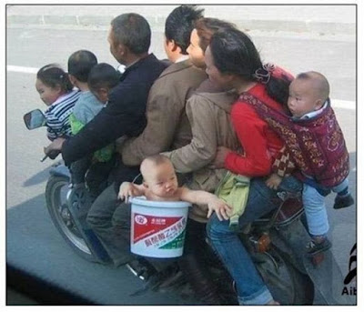 A family on a single motorcycle