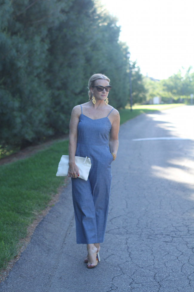 jcrew jumpsuit, clare v clutch, gold statement earrings